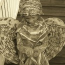 "I asked my 8 yr old daughter Trinity what she wanted to be for Halloween...she replied with ""a cemetery angel\"" - a challenge was made!I bough"