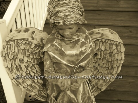 """I asked my 8 yr old daughter Trinity what she wanted to be for Halloween...she replied with \""""a cemetery angel\"""" - a challenge was made!I bough"""