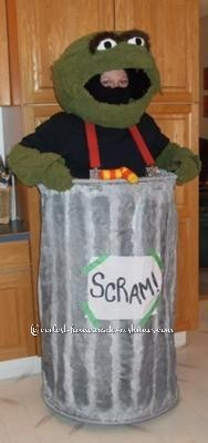 I spotted the perfect Oscar the grouch color blanket and set about making a costume. The head was made out of duct tape and wire, then I glue gunned