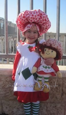 This costume was home sewn. I had a doll of the old version of strawberry shortcake and I basically copied it. I used a regular dress pattern and add