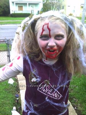 This costume is completely homemade by me. My daughter decided as a joke she wanted to be a zombie cheerleader. Well, trying to find a costume was im