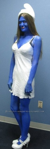 I used body paint ofcourse and my husbands help...this was for my company Halloween Party 2010. I took a simple white dress a few cotton balls- hot g