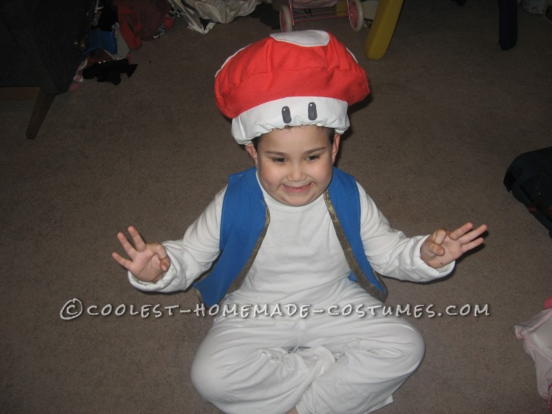 From start to finish I spent 4 hours making this toad costume.  It is made of things I found at goodwill.  It consists of a white long slee