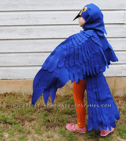 This is a blue Macaw Parrot Costume, Handmade by (Me) a stay at home mom and freelance artist This costume is based around a blue tshirt layere
