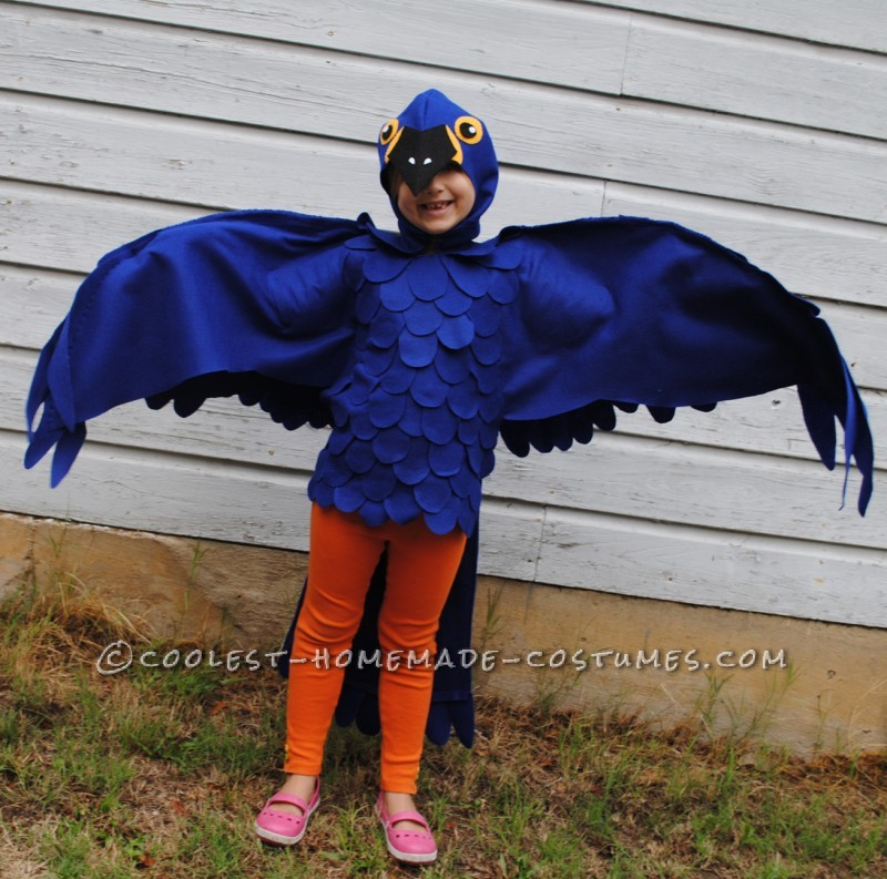This is a blue Macaw Parrot Costume, Handmade by (Me) a stay at home mom and freelance artist This costumeis based around a blue tshirt layere