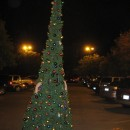 This is a 13 foot tall fully lit Christmas tree with 280 ornaments. The constuction is pvc pipes, garlands, duct tape and two laundry baskets.&