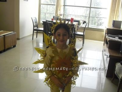 My very creative daughter decided she wants to be a sun for Purim. The internet offered boring/expensive options.  Well, with some arts and craf