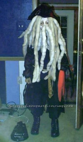 This was a homemade Davey Jones Costume. We bought a pirate hat, but everything else was handmade. We used a black outfit and added lots of cloth scr