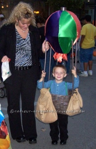 We made my son a hot air balloon a few years ago. This was one of the simplest costumes I ever tried! We created a frame from PVC pipe, painted it br