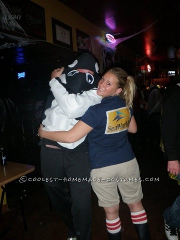 "My husband's nickname is ""Big Orca"" for halloween he was a killed whale and I was a seaworld trainer. We used all materials from Walmart, just a b"