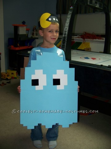 My son wanted to be a light blue Pac Man ghost for Halloween. I took a large piece of cardboard and cut it to shape (I looked at images online to fig