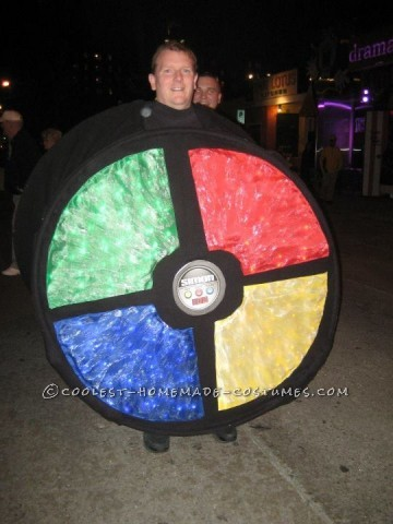 This costume was lit in four colors with a hand controller inside the costume.  The structure was made of bend PVC pipe covered in fabric and li