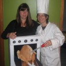My wife and I are pictured here last Halloween…I'm the one on the left, wearing the oven and thrusting forth my five-month pregnant bell