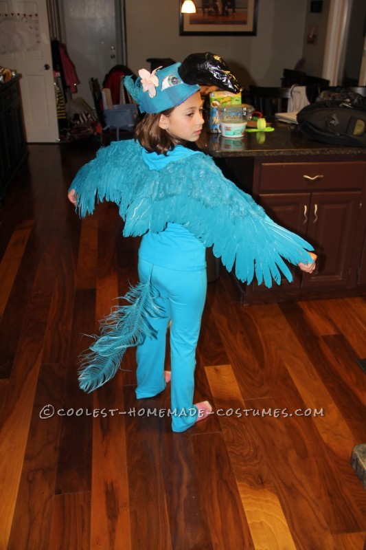 My name is Kaila, I'm 8 years old and made this costume with my grandma and grandpa. First I cut the brim off my brothers baseball hat (he still doe