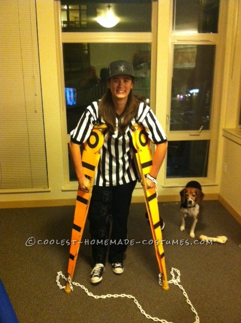 "Creative Football Referee Costume with ""Measuring"" Crutches"