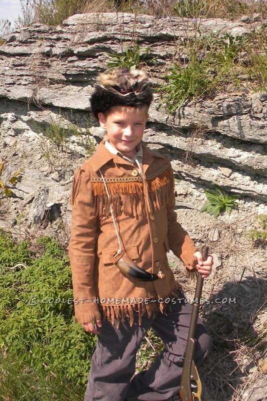 Here is my son in hisDavy Crockett AKA Daniel Boone costume created by his grandmother. She used a faux suede fabric for jacket with coor