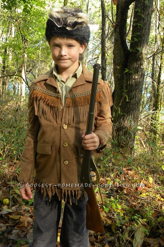 Here is my son in his Davy Crockett AKA Daniel Boone costume created by his grandmother.  She used a faux suede fabric for jacket with coor