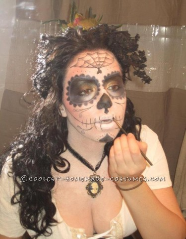 I started off wanting to incorporate the popular Dia de los Muertos skull candy makeup into a halloween costume.  I was inspired by photos I fou