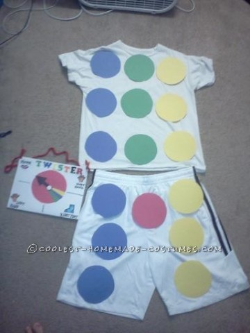 Buy a white t-shirt and white shorts or pants. This costume requires 4-10 pieces of construction paper of 4 different colors (to make the circles) an