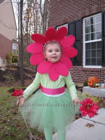 In keeping with the nature theme, our daughter dressed as a flower the year our son dressed as an apple tree! To put together the flower costum