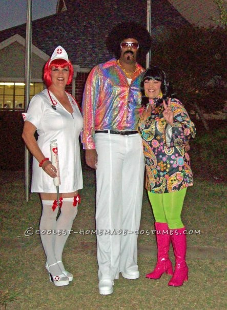 My 6ft7in tall man added height with his 4 inch white platform shoes and his 5 inch high afro. We always have to go all out with costumes. We go to t