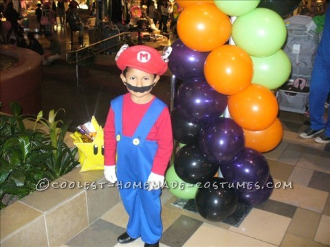 Made the hat from felt and the overalls from blue nylon material. It was not too difficult and it was a halloween when mario was not as popular. We p