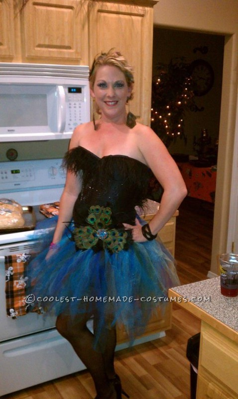 I had a lot of fun making this costume!  I saw a tutu on pinterest and that was my inspiration!  I love the colors of a peacock so I k