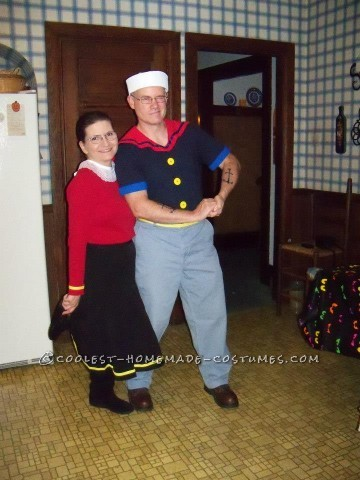 The Popeye costume was a combination of: a simple navy v-neck, a cut-out from a red polo, corn cob pipe, sailor hat, yellow bias tape belt, navy heat