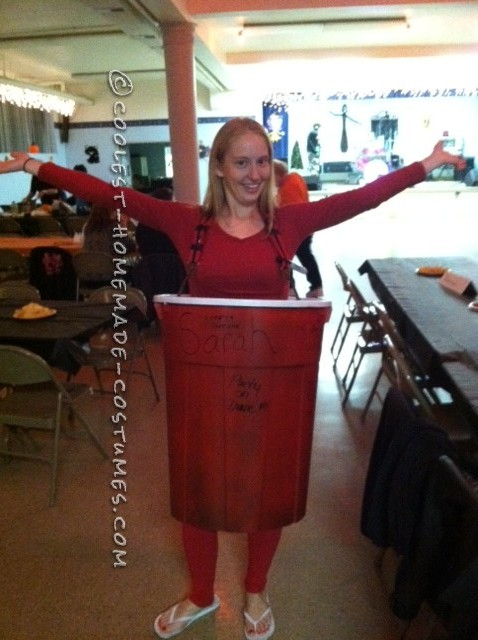 "I used a garbage can to make my costume. I spray painted the inside white and the outside red. On each side I wrote ""solo"" and In the front on the"