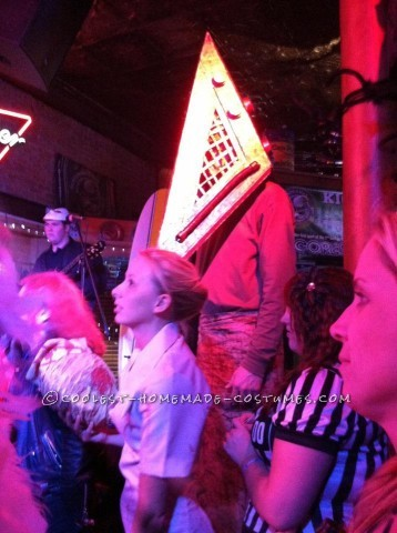 We are the Pyramid Head and bobblehead nurse from the movie silent hill. with the 3D movie just coming out it was perfect for us to dress up as them!