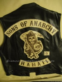 Had everyone get all black leather vest ( you can always get a black sweatshirt and cut the arms off and cut down the middle front to make it like a