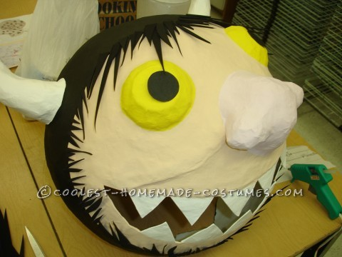 Paint the Pupil black, Add Faom Hair with Hot Glue