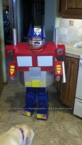 My son loved Transformers, especially Optimus Prime!  So, we decided to attempt making Optimus Prime.   My wife used numerous boxes, paper