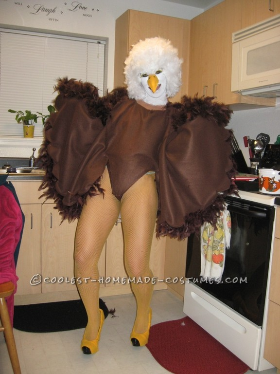 I used several materials. I first got a brown leotard and hot glued on brown feather boas to the back side of the leotard. Then using Fleece fabric a