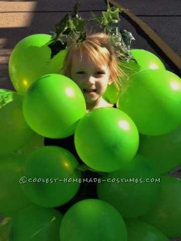 "Got Grapes?   This is Ms. Audrey Lee. Her ""bunch -o -grapes"" costume was created simply (and afford -ably) with green balloons, a"