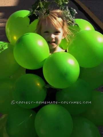 """Got Grapes?  This is Ms. Audrey Lee. Her """"bunch -o -grapes"""" costume was created simply (and afford -ably) with green balloons, a"""