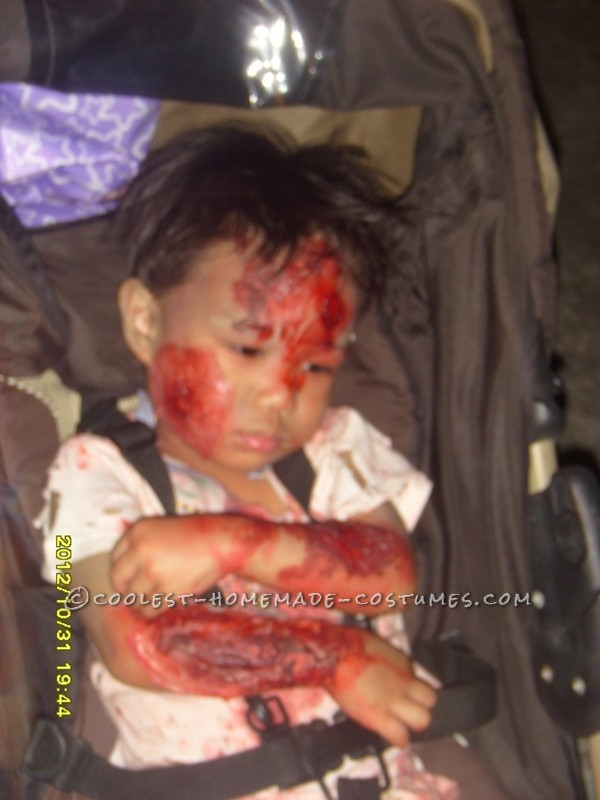 My son, Elijah Seraphiel Basanal, 2yrs old, is wearing bloody zombie costume. I\'ve researched the ideas online on how to do fake wounds and