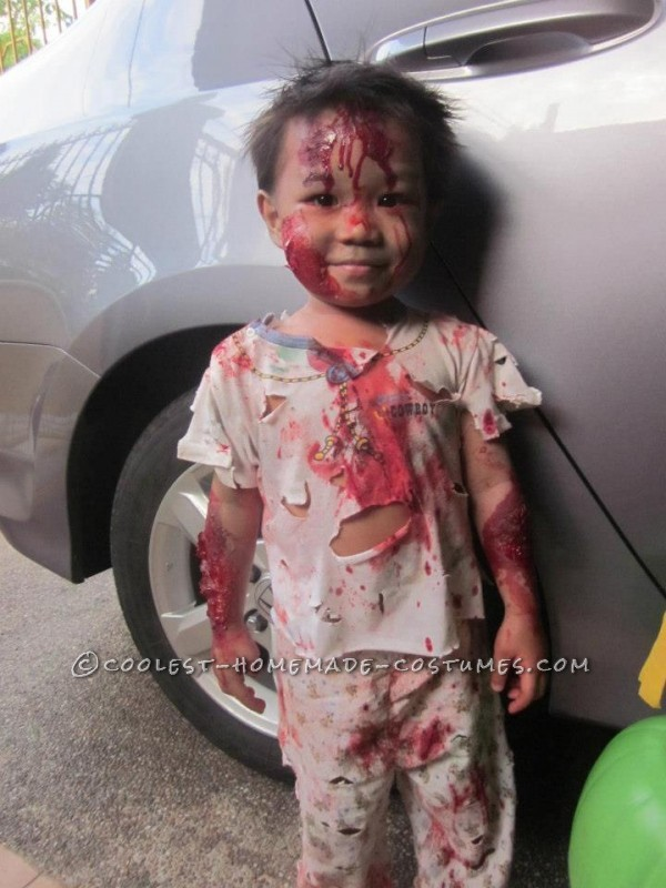 My son, Elijah Seraphiel Basanal, 2yrs old, is wearing bloody zombie costume.I\'ve researched the ideas online on how to do fake wounds and