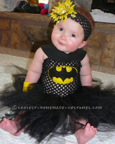 Pretty simple, just a black tutu dress. I made the bracelets from flannel, and the bat logo was made from felt and sewn on. I sewed on the bottom hal