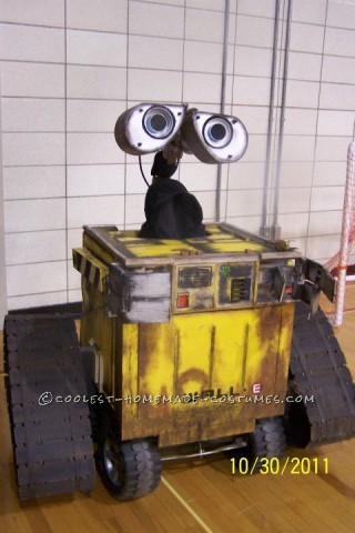 Coolest Homemade Driving Built-to-Scale Wall-E Halloween Costume: Our R2D2 was such a hit the previous year that my husband decided to make a full size, to scale Wall-E from the movie. He drew out the plans and made