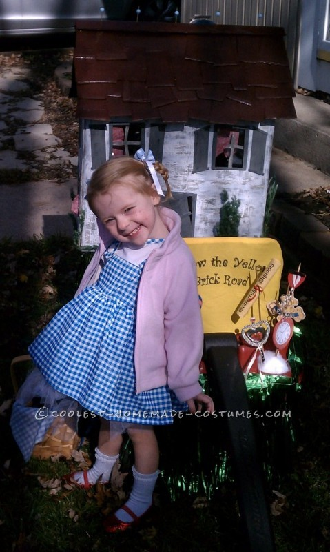 Emilia, age 2 choose Dorothy from the Wizard of Oz as her Halloween costume.  Pulling her in a wagon was the perfect set up for her house prop.&