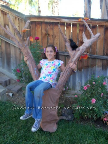 Original Girl in a Tree Illusion Costume: My ten year old daughter came up with this idea and built just about all of this costume by herself. She won the grand prize at her school's trunk-a-t