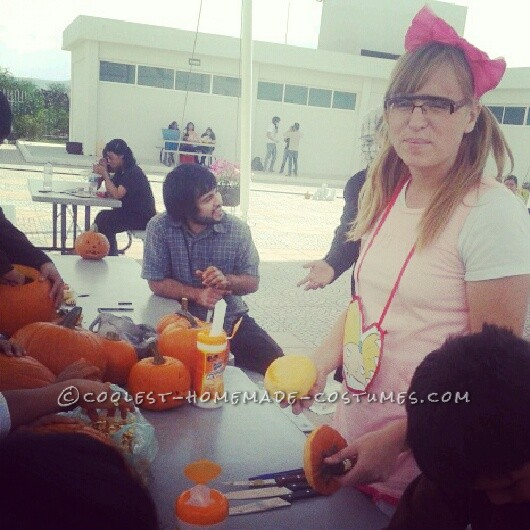 Helga carving pumpkins with the kids