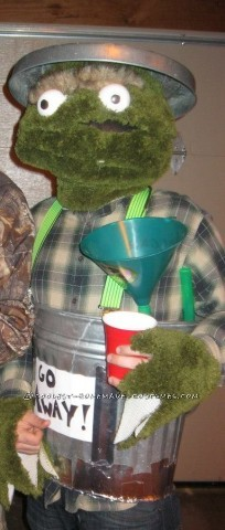 Fun Homemade Oscar the Grouch Halloween Costume: I got most of my materials for Oscar the Grouch costume at Wallmart! The green fur is made out of green bath rugs. I had an old wire hanging flower p