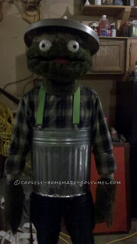 Fun Homemade Oscar the Grouch Halloween Costume: I got most of my materials forOscar the Grouch costume at Wallmart! The green fur is made out of green bath rugs. I had an old wire hanging flower p
