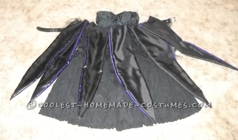 Coolest Homemade Ursula the Sea Witch Costume: I started with a bustier and a crinkle skirt. I bought a ton of black mesh, and made a tutu by tying cut strips to elastic. This sat under the tentacl