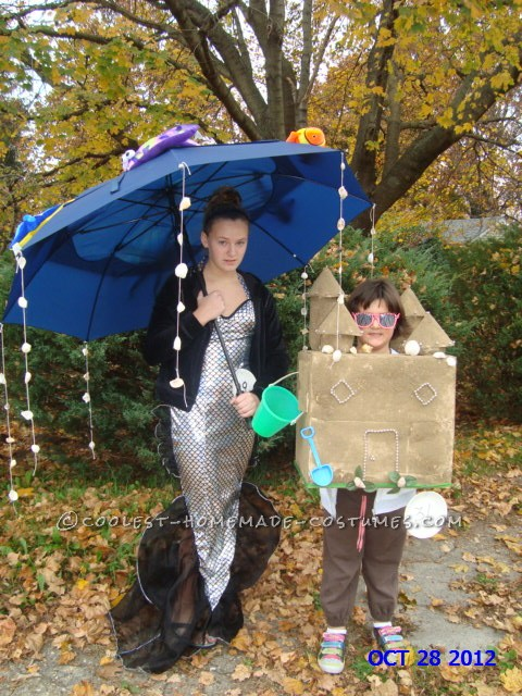 Summertime Dreams of Mermaids and Sandcastles Couple Costume: Prep time for this summertime dreams of Mermaids and Sandcastles couple costume: 6 hours  Costume materials:  sturdy cardboard box, sand, seashe