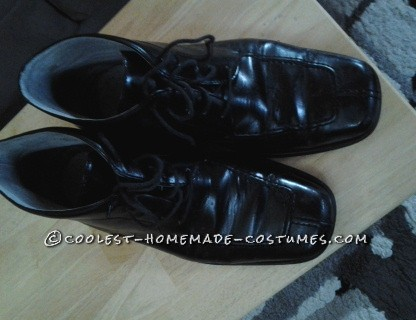 black dress shoes... you want something similar to what would have been worn in the 1800's.