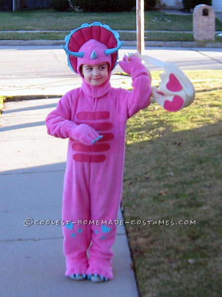 Homemade Pink Triceratops Halloween Costume for a Girl: My niece is a real girly girl most of the time, but she also likes bugs and dinosaurs. When she saw a pattern I had for dinosaur costumes (Simplicity