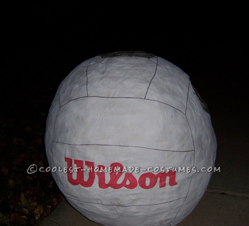 I made this costume by paper macheing a 4 foot beach ball. I did 5 layers of paper mache, 4 layers with newspaper and the last layer with rippe